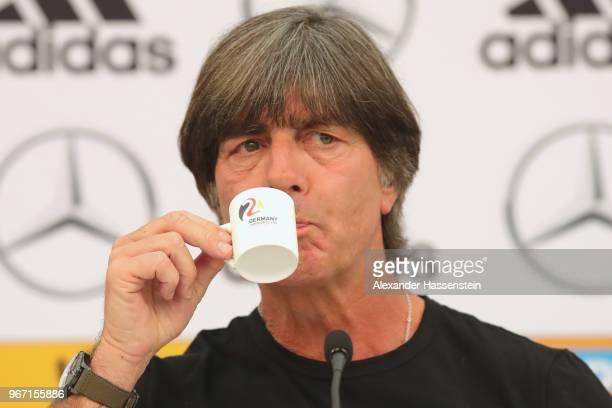 Joachim Loew head coach of the German national team enjoys a espresso during a press conference of the German national team at Sportanlage Rungg on...