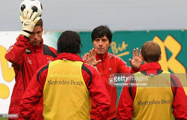 Joachim Loew head coach of the German National team gives instructions to his players during a training session of the German National team at the...
