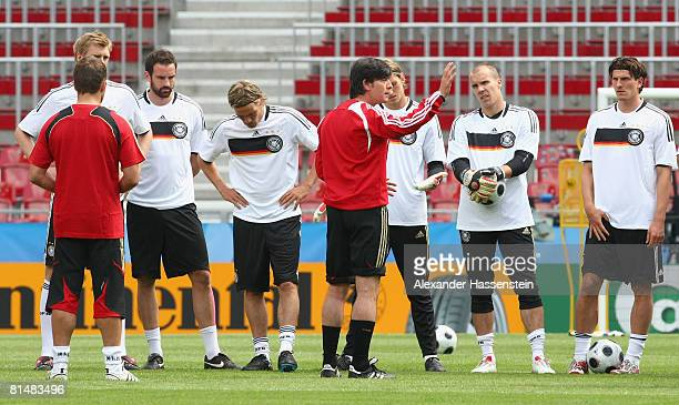 Joachim Loew , head coach of the German national team, gives instructions to his players during the training session of the German national team at...