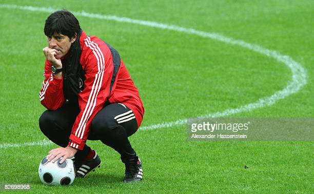 Joachim Loew head coach of the German National team looks on during a training session of the German National team at the AFG Arena on September 7...