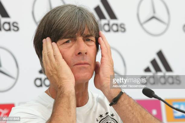 Joachim Loew head coach of the German national team reacts during a press conference of the German national team at Sportanlage Rungg on day ten of...