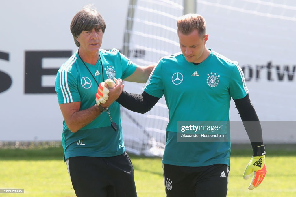 Joachim Loew, head coach of the German national team shake hands with his keeper Marc-Andre ter-Stegen during a training session of the German national team at Sportanlage Rungg on day ten of the Southern Tyrol Training Camp on June 1, 2018 in Eppan, Italy.