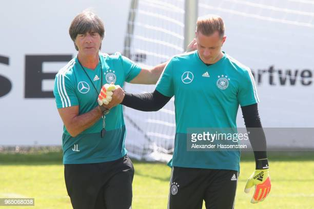 Joachim Loew head coach of the German national team shake hands with his keeper MarcAndre terStegen during a training session of the German national...