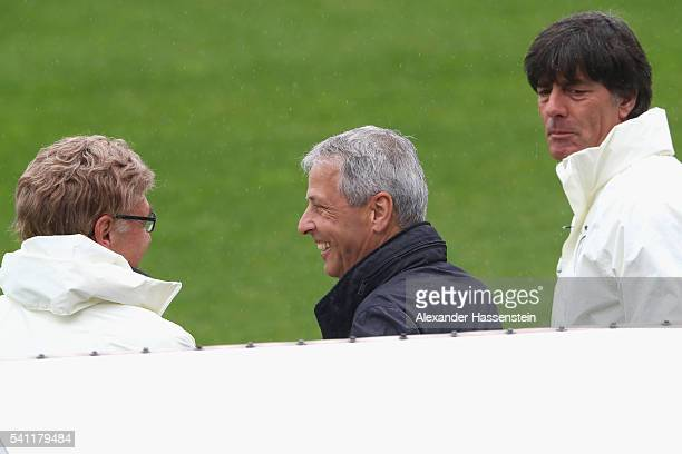 Joachim Loew head coach of the German national team talks to football coach Lucien Favre and team Germany scout Urs Siegenthaler during a Germany...