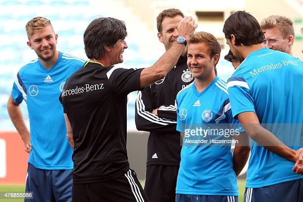 Joachim Loew head coach of the German national team talks to his players during a training session ahead of their Euro 2016 Qualifier against...