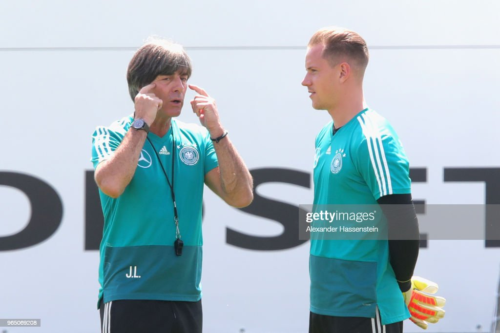 Joachim Loew, head coach of the German national team talks to his keeper Marc-Andre ter-Stegen during a training session of the German national team at Sportanlage Rungg on day ten of the Southern Tyrol Training Camp on June 1, 2018 in Eppan, Italy.