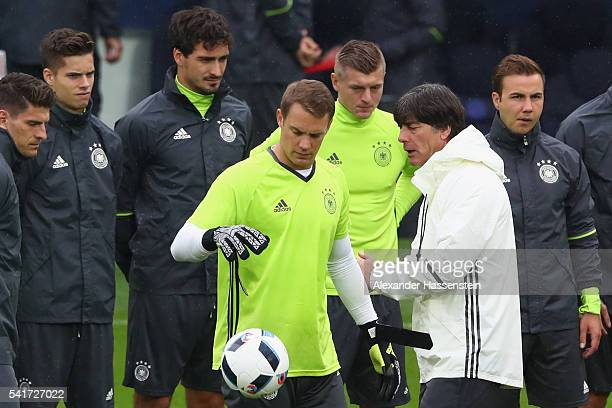 Joachim Loew head coach of the German national team talks to his players prior to a team Germany training session ahead of the UEFA EURO 2016 Group C...