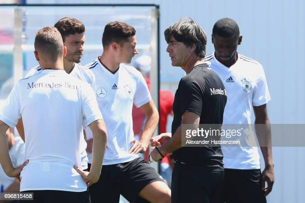 Joachim Loew head coach of the German national team talks to his players prior to a team Germany training session at Park Arena training ground on...
