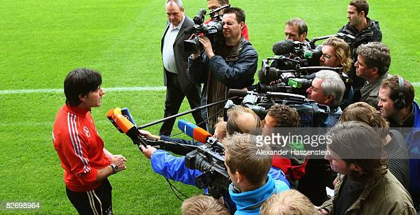 Joachim Loew head coach of the German National team talks to the media after a training session of the German National team at the AFG Arena on...