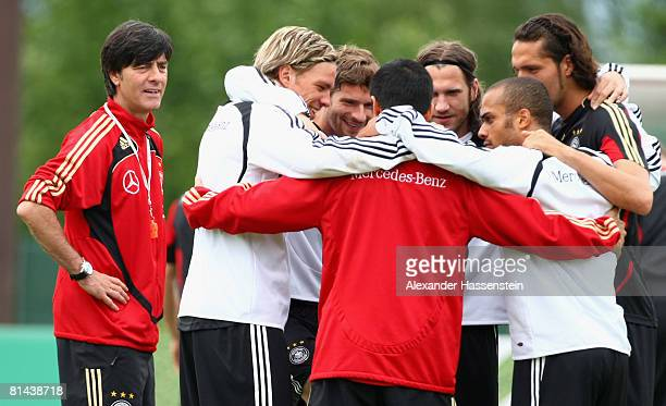 Joachim Loew head coach of the German national team watches his players Clemens Fritz Arne Friedrich Torsten Frings David Odonkor and Kevin Kuranyi...