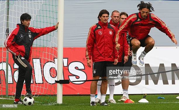 Joachim Loew head coach of the German National team watches his players Kevin Kuranyi Patrick Helmes Christian Pander and Mario Gomez during a...