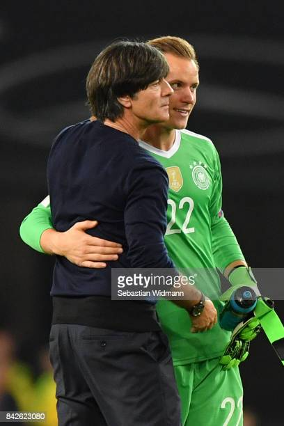 Joachim Loew national coach of Germany and MarcAndre ter Stegen of Germany embrace after the FIFA 2018 World Cup Qualifier between Germany and Norway...