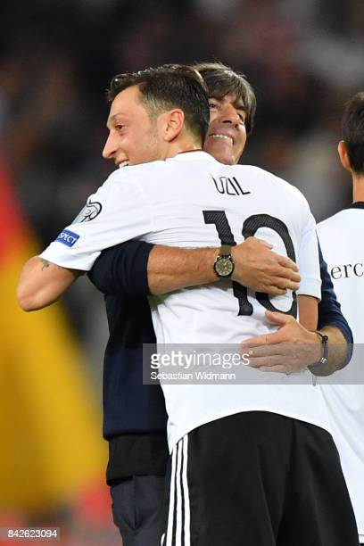 Joachim Loew national coach of Germany and Mesut Oezil of Germany embrace after the FIFA 2018 World Cup Qualifier between Germany and Norway at...