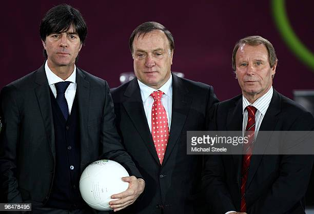 Joachim Low coach of Germany Dick Advocaat coach of Belgium and Berti Vogts coach of Azerbaijan pose after being drawn in Group A during the Euro2012...