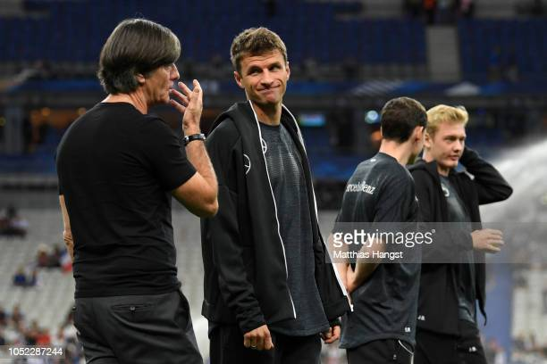 Joachim Low Manager of Germany speaks with Thomas Mueller of Germany prior to the UEFA Nations League A group one match between France and Germany at...