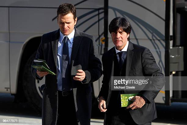 Joachim Low the Germany coach arrives with assistant Oliver Bierhoff for the Euro2012 Qualifying Draw at the Palace of Culture and Science on...