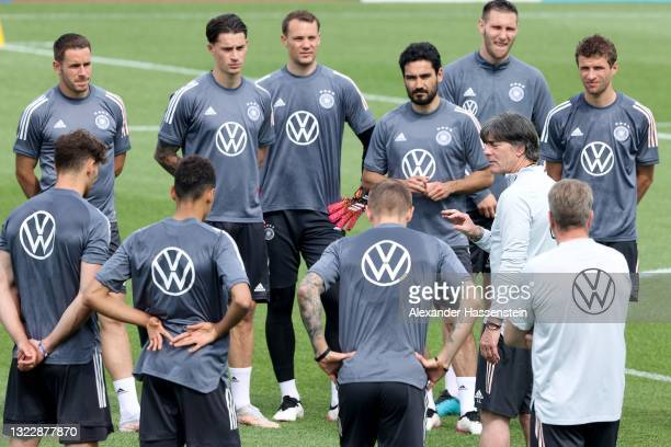 Joachim Löw, head coach of Germany talks to his players during a training session of the German national team at the EURO 2020 training camp at...