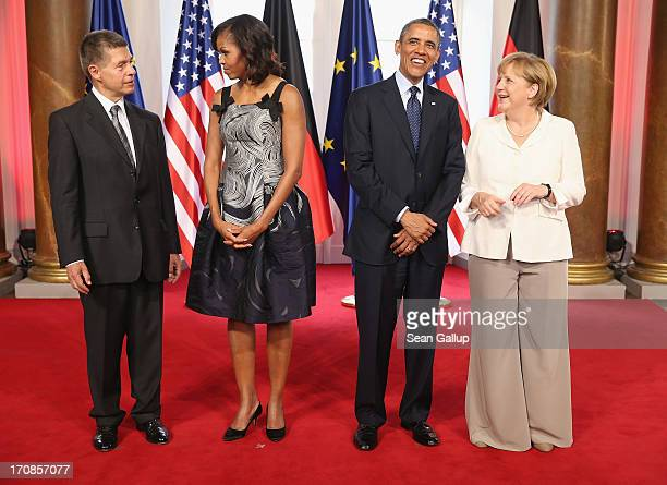 US Joachim Sauer First Lady Michelle Obama US President Barack Obama and German Chancellor Angela Merkel attend the dinner given in honour of...