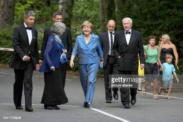 Joachim Sauer his son Daniel Sauer writer Ulla Hahn German Chancellor Angela Merkel and Klaus von Dohnanyi former first mayor of Hamburg arrive for...