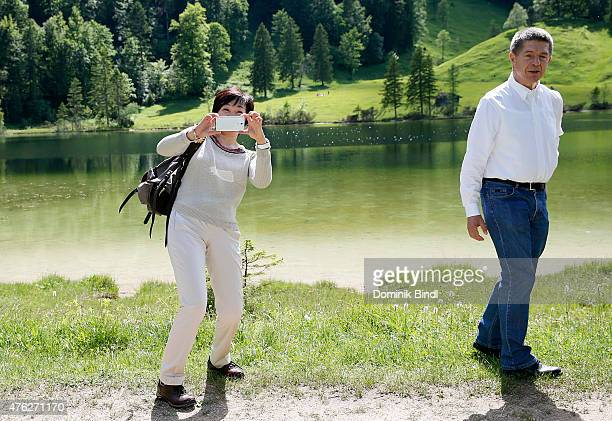 Joachim Sauer husband of German Chancellor Angela Merkel and Akie Abe wife of Japanese Prime Minister Shinzo Abe take a walk at Ferchensee in the...