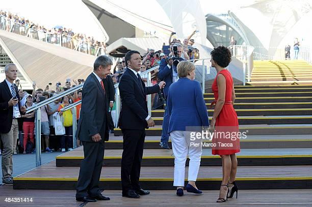 Joachim Saurer Italian Prime Minister Matteo Renzi German Chancellor Angela Merkel and Agnese Landini attend the visit at the pavilion of Germany...