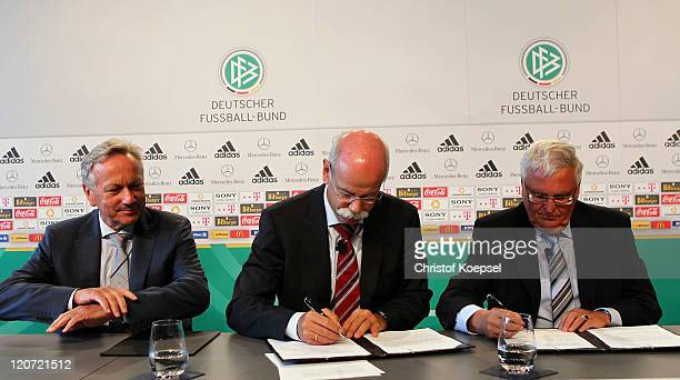 Joachim Schmidt, distribution and marketing manager of Mercedes-Benz watches Dieter Zetsche, chairman of the board of Mercedes-Benz signs a treaty...