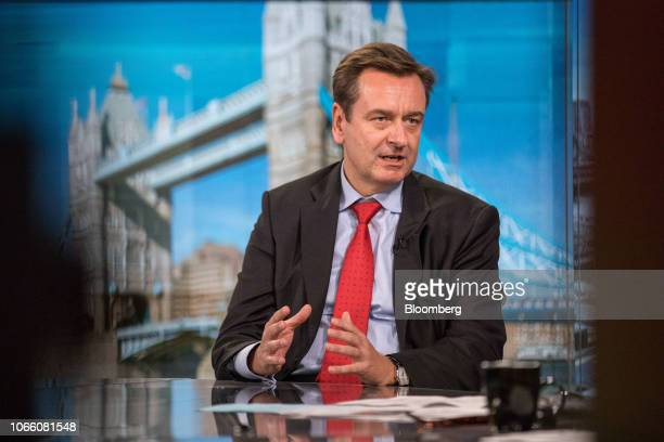 Joachim Wenning chief executive officer of Munich Re gestures while speaking during a Bloomberg Television interview in London UK on Wednesday Nov 28...