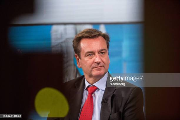 Joachim Wenning chief executive officer of Munich Re pauses during a Bloomberg Television interview in London UK on Wednesday Nov 28 2018 The cost of...