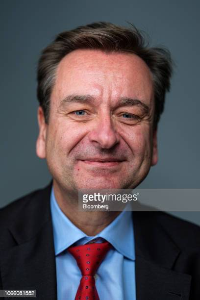 Joachim Wenning chief executive officer of Munich Re poses for a photograph following a Bloomberg Television interview in London UK on Wednesday Nov...