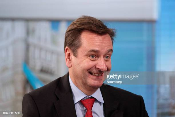 Joachim Wenning chief executive officer of Munich Re reacts during a Bloomberg Television interview in London UK on Wednesday Nov 28 2018 The cost of...