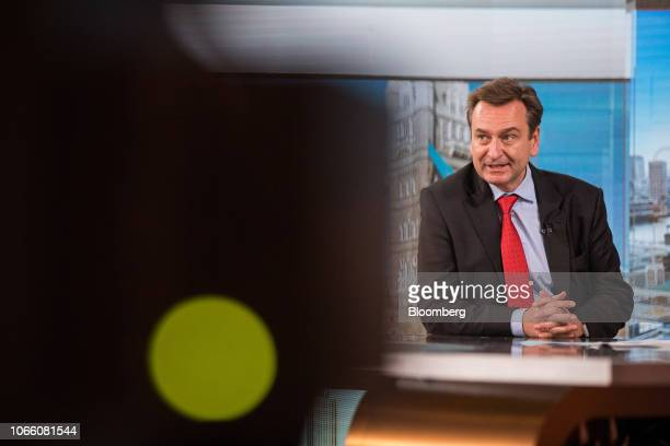 Joachim Wenning chief executive officer of Munich Re speaks during a Bloomberg Television interview in London UK on Wednesday Nov 28 2018 The cost of...