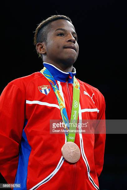 Joahnys Cuba Argilagos of Cuba poses on the podium during the medal ceremony for the Men's Boxing Light Fly Final on Day 9 of the Rio 2016 Olympic...