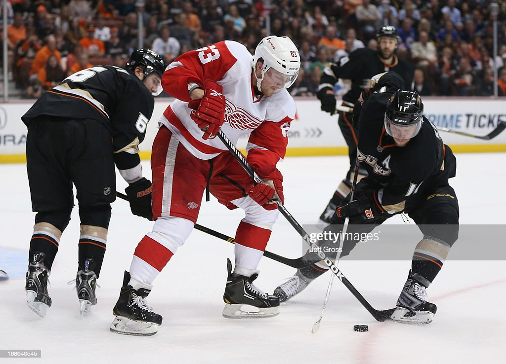 Joakim Andersson #63 of the Detroit Red Wings and Saku Koivu #11 of the Anaheim Ducks fight for the puck in the third period of Game Seven of the Western Conference Quarterfinals during the 2013 NHL Stanley Cup Playoffs at Honda Center on May 12, 2013 in Anaheim, California. The Red Wings defeated the Ducks 3-2.