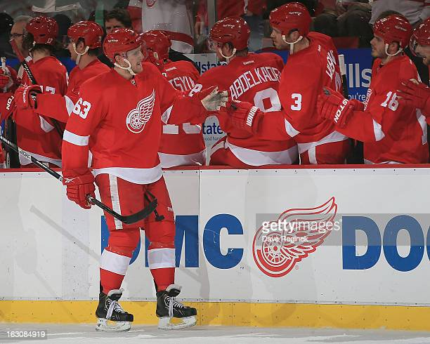 Joakim Andersson of the Detroit Red Wings celebrates his goal with teammates on the bench during a NHL game against the Vancouver Canucks at Joe...