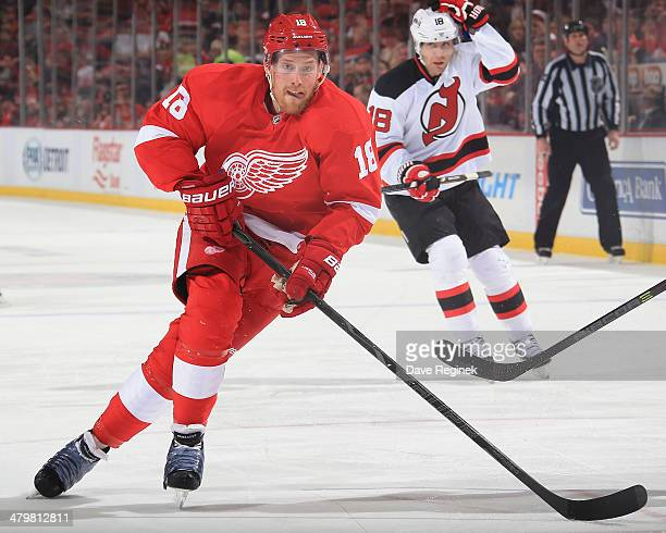 Joakim Andersson of the Detroit Red Wings skates up ice against the New Jersey Devils during an NHL game on March 7 2014 at Joe Louis Arena in...
