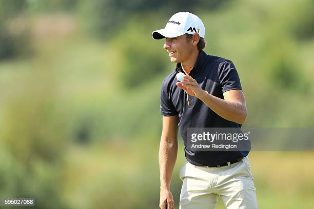 Joakim Lagergren of Sweden acknowledges the crowd on the 9th green during the first round of Made in Denmark at Himmerland Golf Spa Resort on August...