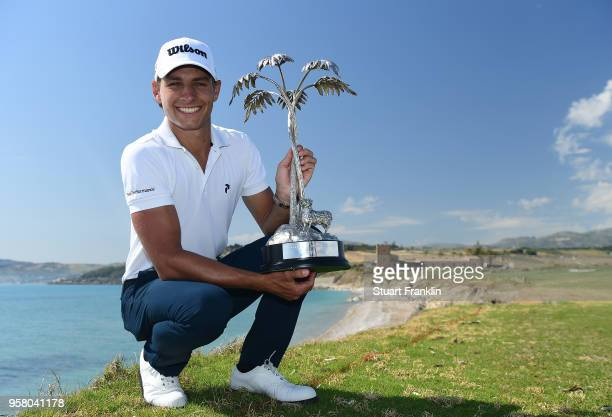 Joakim Lagergren of Sweden holds the trophy after winning the The Rocco Forte Open at the Verdura Gol Resort on May 13 2018 in Sciacca Italy
