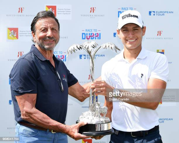 Joakim Lagergren of Sweden is presented with the trophy by Sir Rocco Forte after winning the The Rocco Forte Open at the Verdura Gol Resort on May 13...