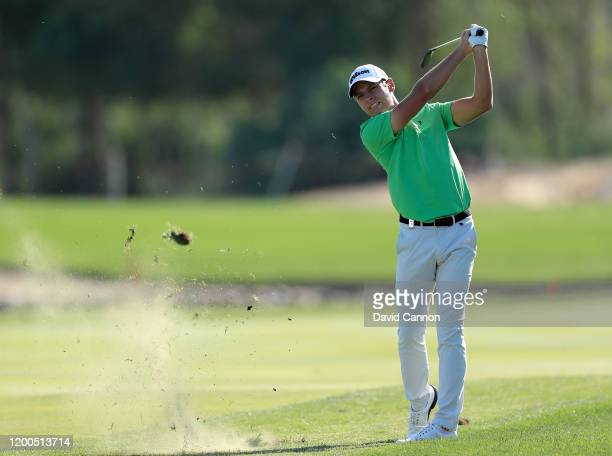Joakim Lagergren of Sweden plays his second shot on the 17th hole during the final round of the Abu Dhabi HSBC Championship at Abu Dhabi Golf Club on...