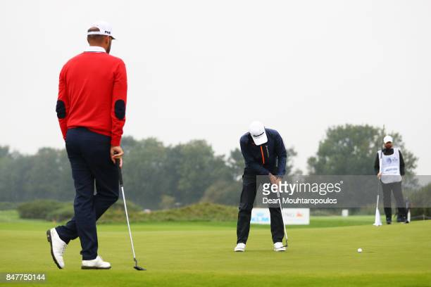 Joakim Lagergren of Sweden puts as Gregory Havret of France looks on during day three of the KLM Open at The Dutch on September 16 2017 in Spijk...