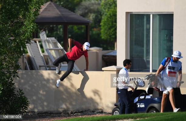 Joakim Lagergren of Sweden retrieves his ball from a nearby garden alongside the 3rd hole during day one of the DP World Tour Championship at...