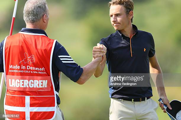 Joakim Lagergren of Sweden shakes hands with caddie Wayne Hussellbury on the 9th green during the first round of Made in Denmark at Himmerland Golf...