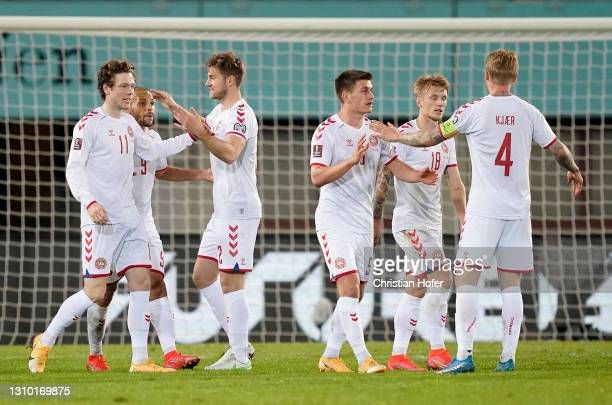 Joakim Maehle of Denamrk celebrates with Simon Kjaer and team mates after scoring their side's second goal during the FIFA World Cup 2022 Qatar...