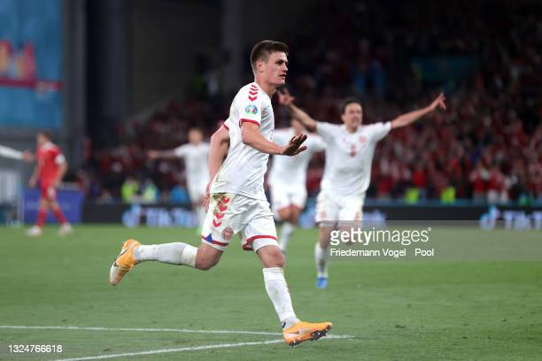Joakim Maehle of Denmark celebrates after scoring their team's fourth goal during the UEFA Euro 2020 Championship Group B match between Russia and...
