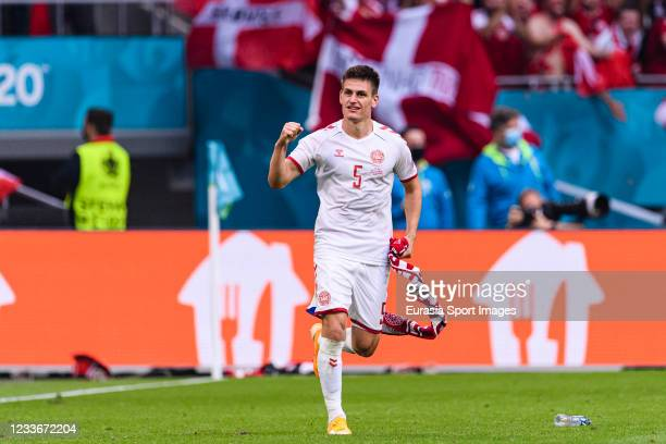 Joakim Maehle of Denmark celebrates after winning against Wales during the UEFA Euro 2020 Championship Round of 16 match between Wales and Denmark at...