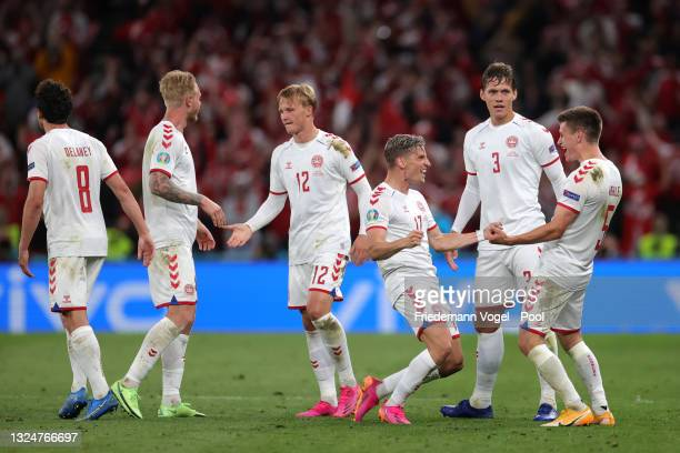 Joakim Maehle of Denmark celebrates with teammates Jens Stryger Larsen and Jannik Vestergaard after scoring their team's fourth goal during the UEFA...