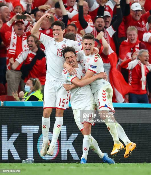 Joakim Maehle of Denmark celebrates with teammates Thomas Delaney and Christian Norgaard after scoring their side's fourth goal during the UEFA Euro...