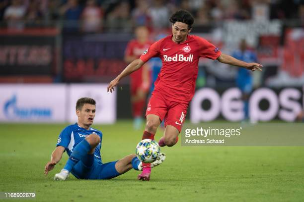 Joakim Maehle of KRC Genk and Takumi Minamino of FC Salzburg during the champions league group E match between FC Salzburg and KRC Genk at Salzburg...