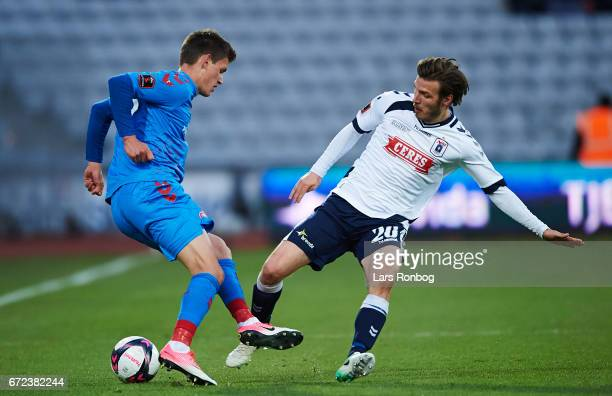 Joakim Mahle of AaB Aalborg and Elmar Bjarnason of AGF Aarhus compete for the ball during the Danish Alka Superliga match between AGF Aarhus and AaB...