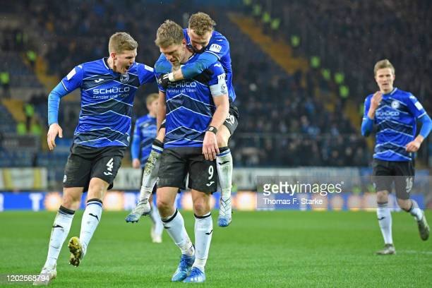 Joakim Nilsson Fabian Klos and Marcel Hartel of Bielefeld celebrate their teams second goal during the Second Bundesliga match between DSC Arminia...